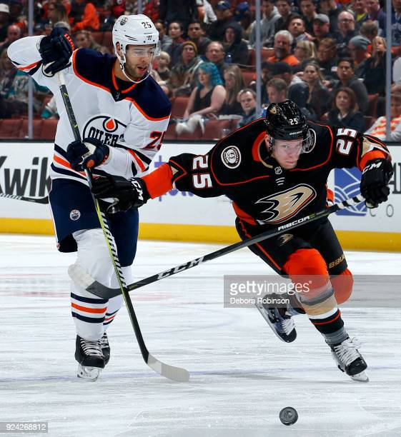 Darnell Nurse of the Edmonton Oilers battles for the puck against Ondrej Kase of the Anaheim Ducks during the game on February 25 2018 at Honda...