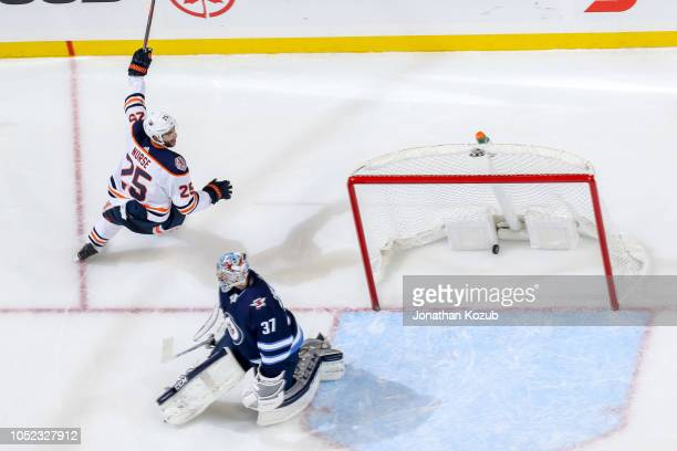 Darnell Nurse of the Edmonton Oilers celebrates after scoring an overtime goal against goaltender Connor Hellebuyck of the Winnipeg Jets at the Bell...