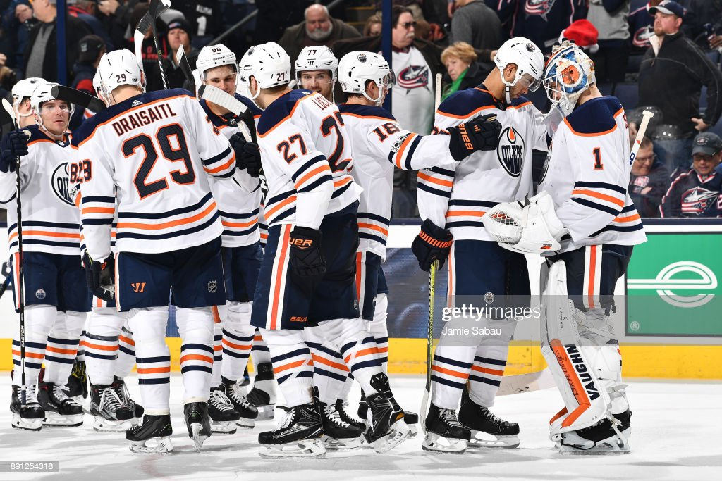 Darnell Nurse #25 of the Edmonton Oilers celebrates with goaltender Laurent Brossoit #1 of the Edmonton Oilers after defeating the Columbus Blue Jackets 7-2 in a game on December 12, 2017 at Nationwide Arena in Columbus, Ohio.