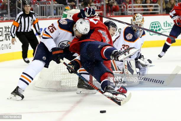Darnell Nurse of the Edmonton Oilers checks Dmitrij Jaskin of the Washington Capitals during the second period at Capital One Arena on November 5...