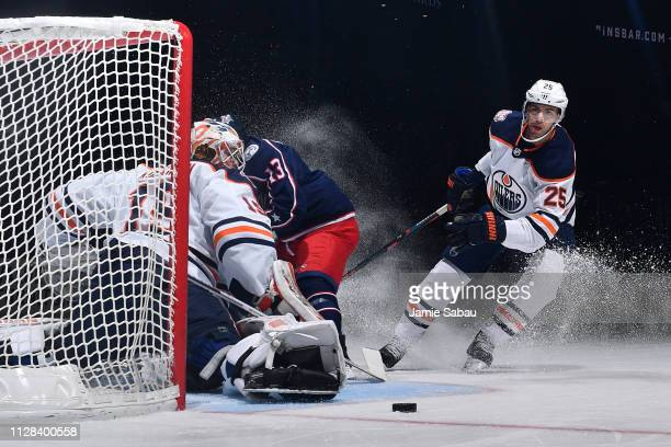 Darnell Nurse of the Edmonton Oilers follows the puck as it goes wide of goaltender Mikko Koskinen of the Edmonton Oilers during the first period of...