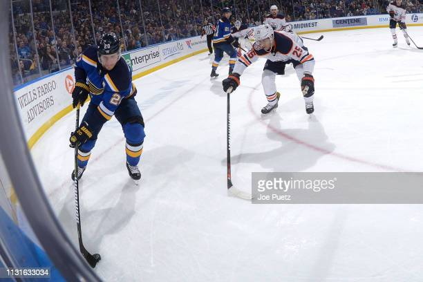 Darnell Nurse of the Edmonton Oilers pressures Alexander Steen of the St Louis Blues at Enterprise Center on March 19 2019 in St Louis Missouri