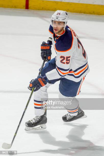 Darnell Nurse of the Edmonton Oilers skates with the puck against the Minnesota Wild during the game at the Xcel Energy Center on April 2 2018 in St...