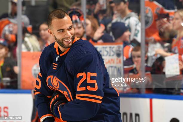 Darnell Nurse of the Edmonton Oilers smiles at fans prior to the game against the St Louis Blues on January 31 at Rogers Place in Edmonton Alberta...