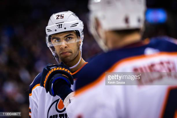 Darnell Nurse of the Edmonton Oilers talks to a teammate during the second period against the Toronto Maple Leafs at the Scotiabank Arena on February...