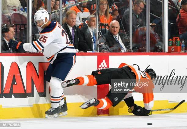 Darnell Nurse of the Edmonton Oilers upends Jori Lehtera of the Philadelphia Flyers at the Wells Fargo Center on October 21 2017 in Philadelphia...