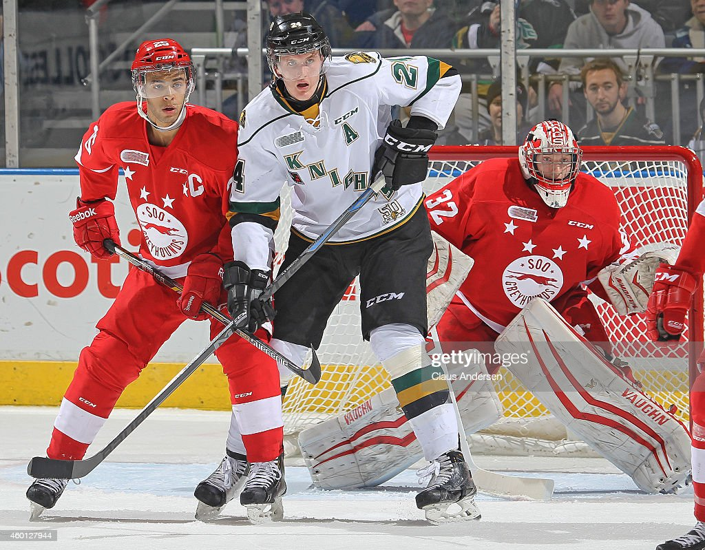 Darnell Nurse #25 of the Sault Ste. Marie Greyhounds skates against Michael McCarron #24 of the London Knights in an OHL game at Budweiser Gardens on December 5, 2014 in London, Ontario, Canada. The Greyhounds defeated the Knights 4-0.