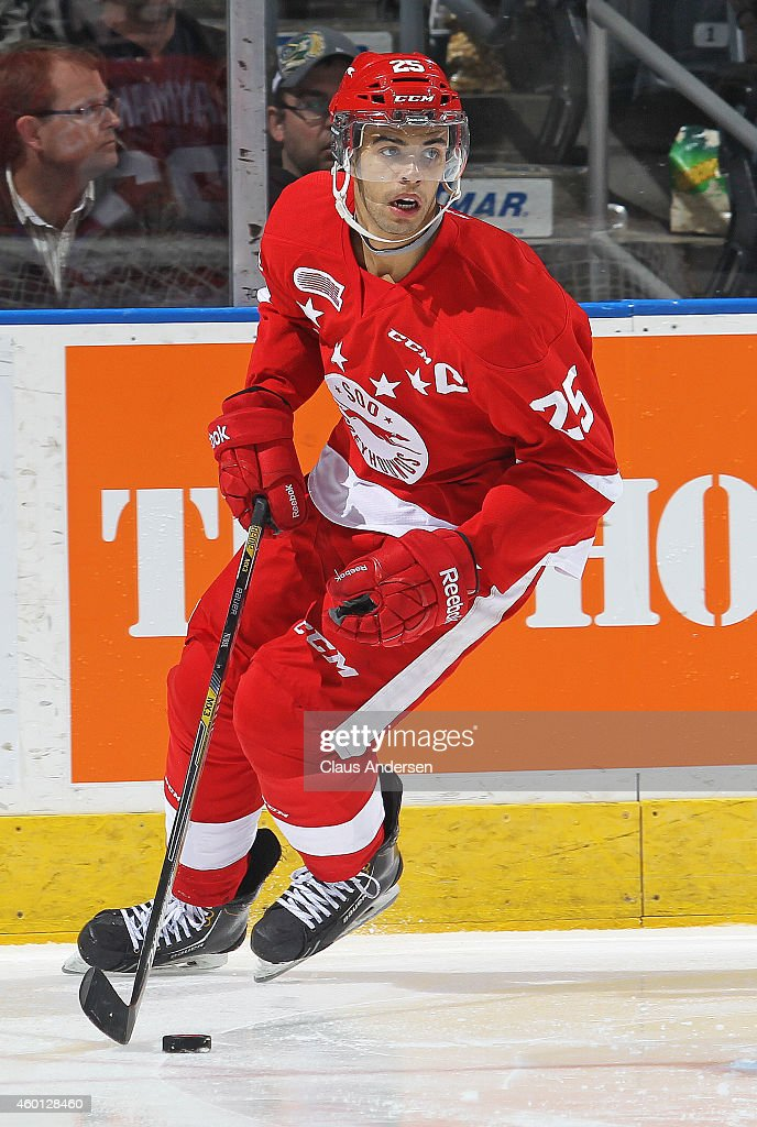 Darnell Nurse #25 of the Sault Ste. Marie Greyhounds skates with the puck against the London Knights in an OHL game at Budweiser Gardens on December 5, 2014 in London, Ontario, Canada. The Greyhounds defeated the Knights 4-0.