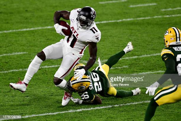 Darnell Savage of the Green Bay Packers attempts to tackle Julio Jones of the Atlanta Falcons during the first half at Lambeau Field on October 05...