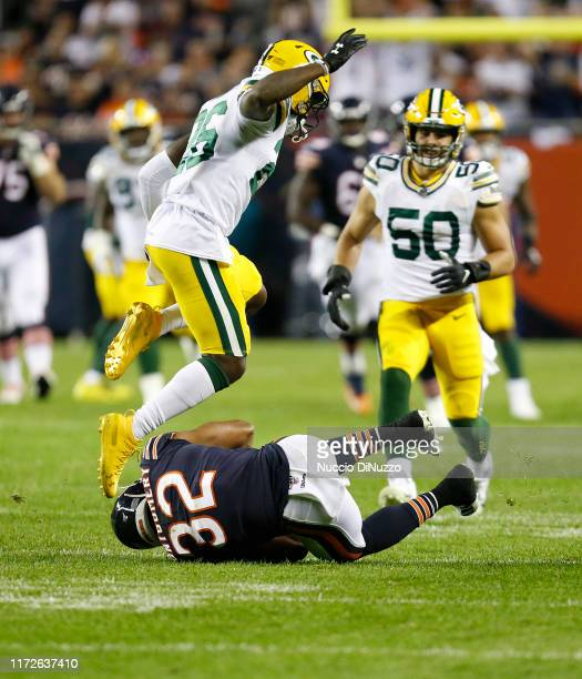 Darnell Savage of the Green Bay Packers leaps to avoid collision with David Montgomery of the Chicago Bears during the second half at Soldier Field...