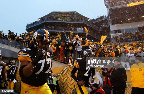 Darnell Stapleton and Dennis Dixon of the Pittsburgh Steelers take the field against the San Diego Chargers during their AFC Divisional Playoff Game...