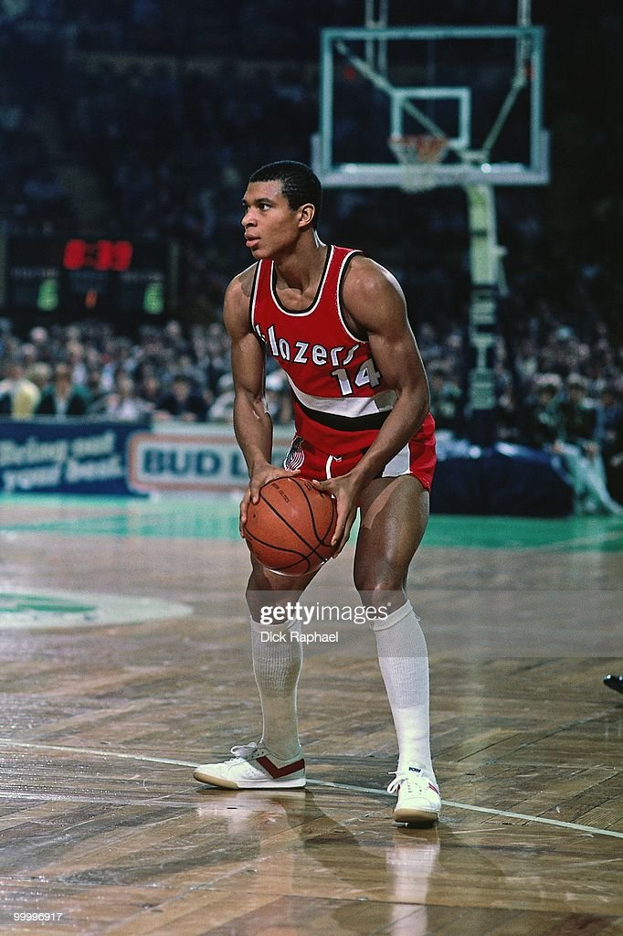Darnell Valentine #14 of the Portland Trail Blazers looks to make a move against the Boston Celtics during a game played in 1983 at the Boston Garden in Boston, Massachusetts.