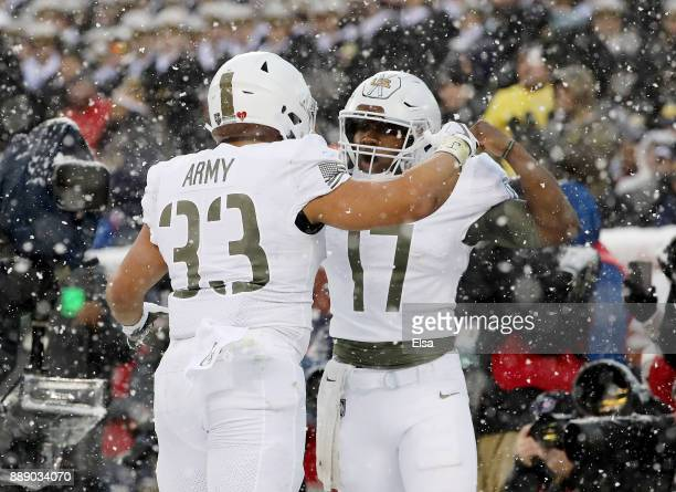 Darnell Woolfolk of the Army Black Knights celebrates his touchdown with teammate Ahmad Bradshaw in the first half against the Navy Midshipmen on...
