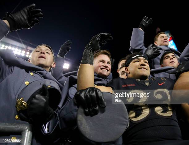 Darnell Woolfolk of the Army Black Knights celebrates the win with the cadets after the game against the Navy Midshipmen at Lincoln Financial Field...