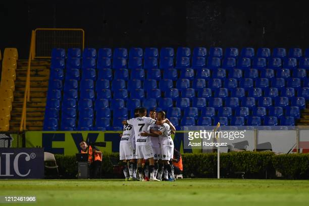 Darío Lezcano of Juárez celebrates with teammates after scoring his team's first goal during the 10th round match between Tigres UANL and FC Juarez...