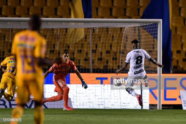 Darío Lezcano of Juárez scores his team's first goal against Nahuel Guzmán of Tigres during the 10th round match between Tigres UANL and FC Juarez as...
