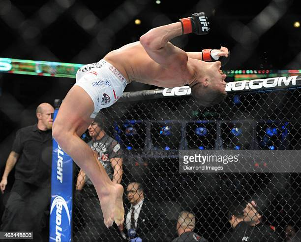 Daron Cruickshank celebrates with a back flip after a stoppage victory after a lightweight bout during UFC on Fox 10 Henderson v Thomson at United...