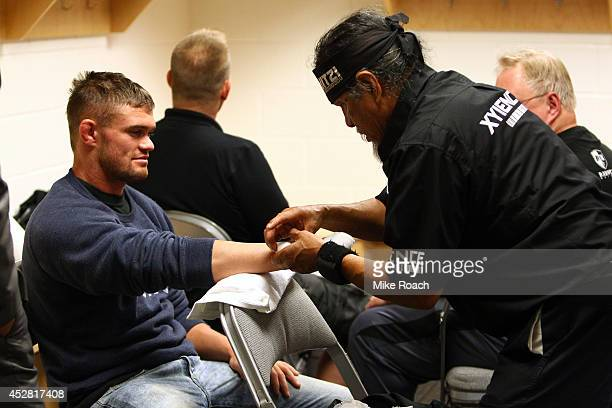 Daron Cruickshank gets his hands wrapped backstage during the UFC Fight Night event at the SAP Center on July 26 2014 in San Jose California