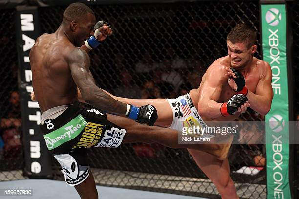 Daron Cruickshank kicks Anthony Njokuani in their lightweight bout at the Scotiabank Centre on October 4 2014 in Halifax Nova Scotia Canada