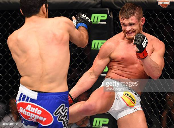 Daron Cruickshank kicks Beneil Dariush in their lightweight bout during the UFC 185 event at the American Airlines Center on March 14 2015 in Dallas...