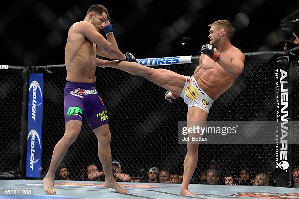 Daron Cruickshank kicks Jorge Masvidal in their lightweight bout during the UFC Fight Night event at the SAP Center on July 26 2014 in San Jose...