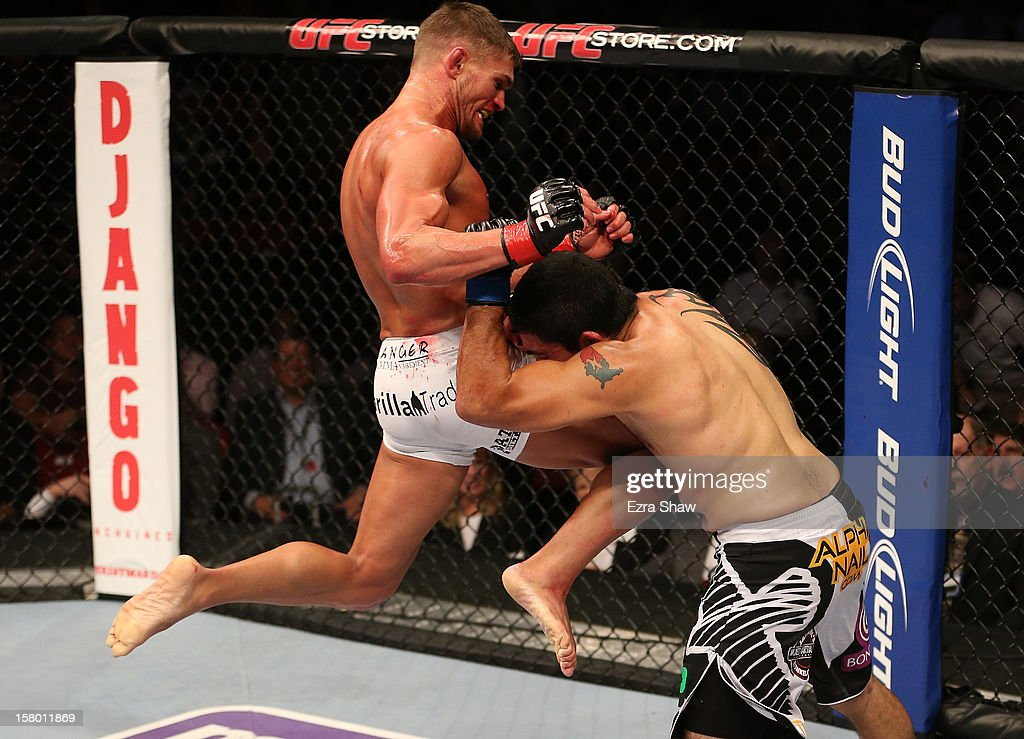 Daron Cruickshank knees Henry Martinez during their lightweight bout at the UFC on FOX event on December 8, 2012 at Key Arena in Seattle, Washington.