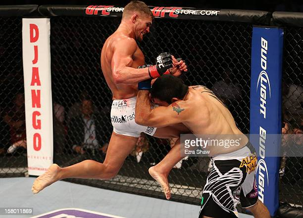 Daron Cruickshank knees Henry Martinez during their lightweight bout at the UFC on FOX event on December 8 2012 at Key Arena in Seattle Washington