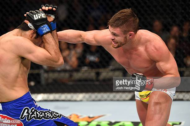 Daron Cruickshank lands a punch against Beneil Dariush in their lightweight bout during the UFC 185 event at the American Airlines Center on March 14...
