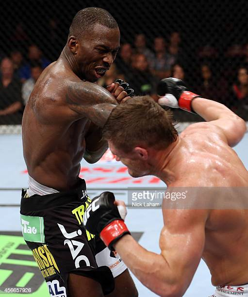 Daron Cruickshank punches Anthony Njokuani in their lightweight bout at the Scotiabank Centre on October 4 2014 in Halifax Nova Scotia Canada
