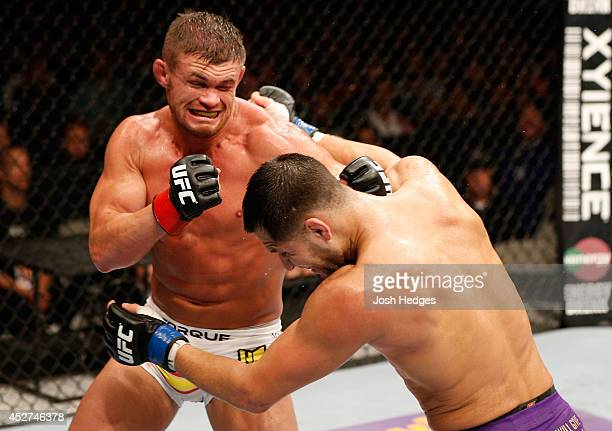 Daron Cruickshank punches Jorge Masvidal in their lightweight bout during the UFC Fight Night event at SAP Center on July 26 2014 in San Jose...