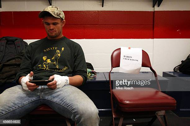 Daron Cruickshank sits backstage during the UFC Fight Night event at the Scotiabank Centre on October 4 2014 in Halifax Nova Scotia Canada
