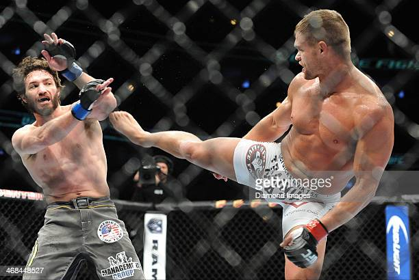 Daron Cruickshank throws a kick at Mike Rio during a lightweight bout during UFC on Fox 10 Henderson v Thomson at United Center in Chicago Illinois