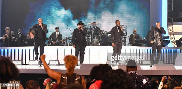 Daron Jones Michael Mike Keith Quinnes 'Q' Parker and Marvin Slim Scandrick of 112 perform during the 2017 Soul Train Music Awards at the Orleans...