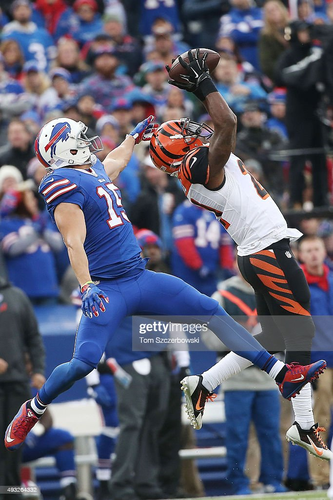 Darqueze Dennard #21 of the Cincinnati Bengals intercepts a pass intended for Chris Hogan #15 of the Buffalo Bills during the first half at Ralph Wilson Stadium on October 18, 2015 in Orchard Park, New York.