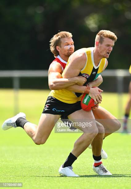 Darragh Joyce of the Saints is tackled by Dan Butler of the Saints during a St Kilda Saints AFL training session at Maroochydore Multi Sport Complex...