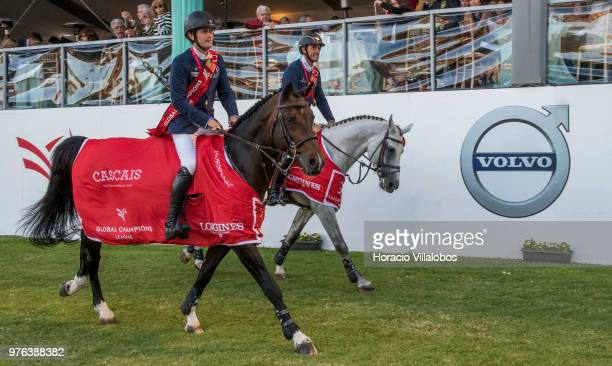 Darragh Kenny and Gregory Wathelet of winning team Paris Panthers perform a victory lap at the end of 'CSI 5' GCL of Cascais Estoril Round 2 155/160m...