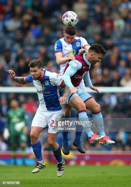 Darragh Lenihan and Danny Guthrie of Blackburn Rovers jump for a header with Scott Hogan of Aston Villa during the Sky Bet Championship match between...