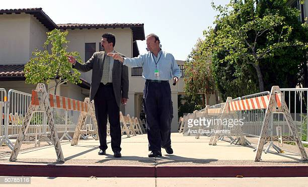 Darrel E. Parker, Assistant Trial Court Executive Officer and K.F.W.B news radio reporter Steven Lentz, discuss media placement on April 29, 2004 in...