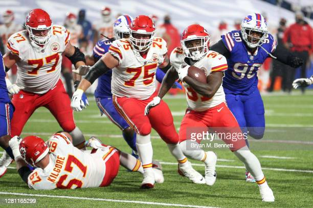 Darrel Williams of the Kansas City Chiefs carries the ball for a thirteen-yard rushing against the Buffalo Bills during the second half at Bills...