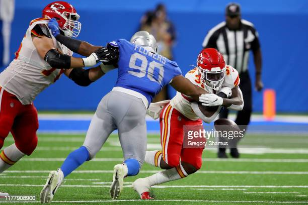 Darrel Williams of the Kansas City Chiefs fumbles the ball against Trey Flowers of the Detroit Lions during the third quarter in the game at Ford...