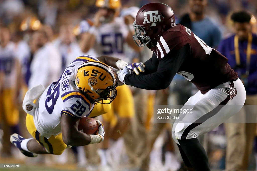 Darrel Williams #28 of the LSU Tigers is tackled by Landis Durham #46 of the Texas A&M Aggies during the first half at Tiger Stadium on November 25, 2017 in Baton Rouge, Louisiana.