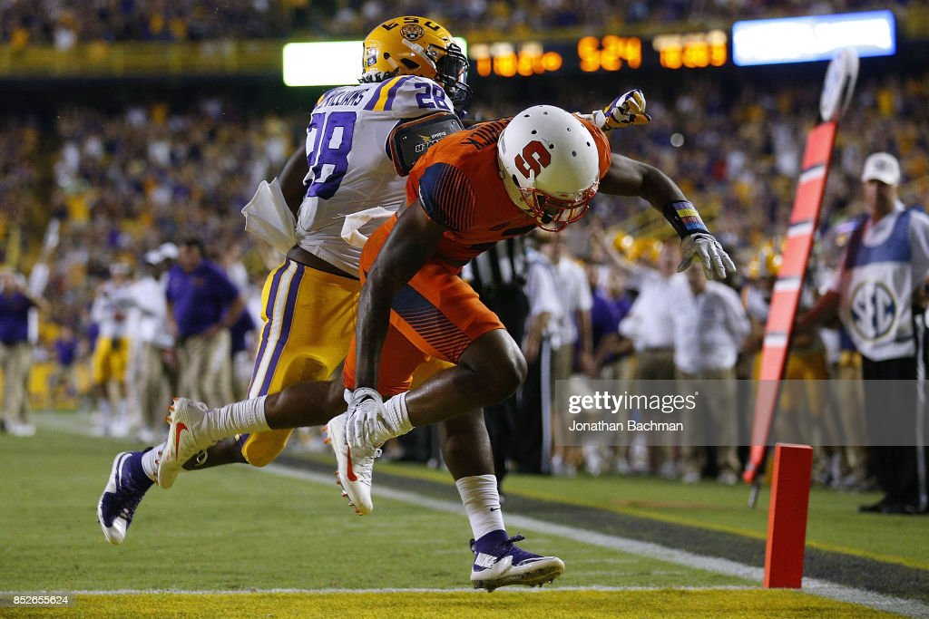 Darrel Williams #28 of the LSU Tigers scores a touchdown as Christopher Fredrick #3 of the Syracuse Orange defends during the second half of a game at Tiger Stadium on September 23, 2017 in Baton Rouge, Louisiana.