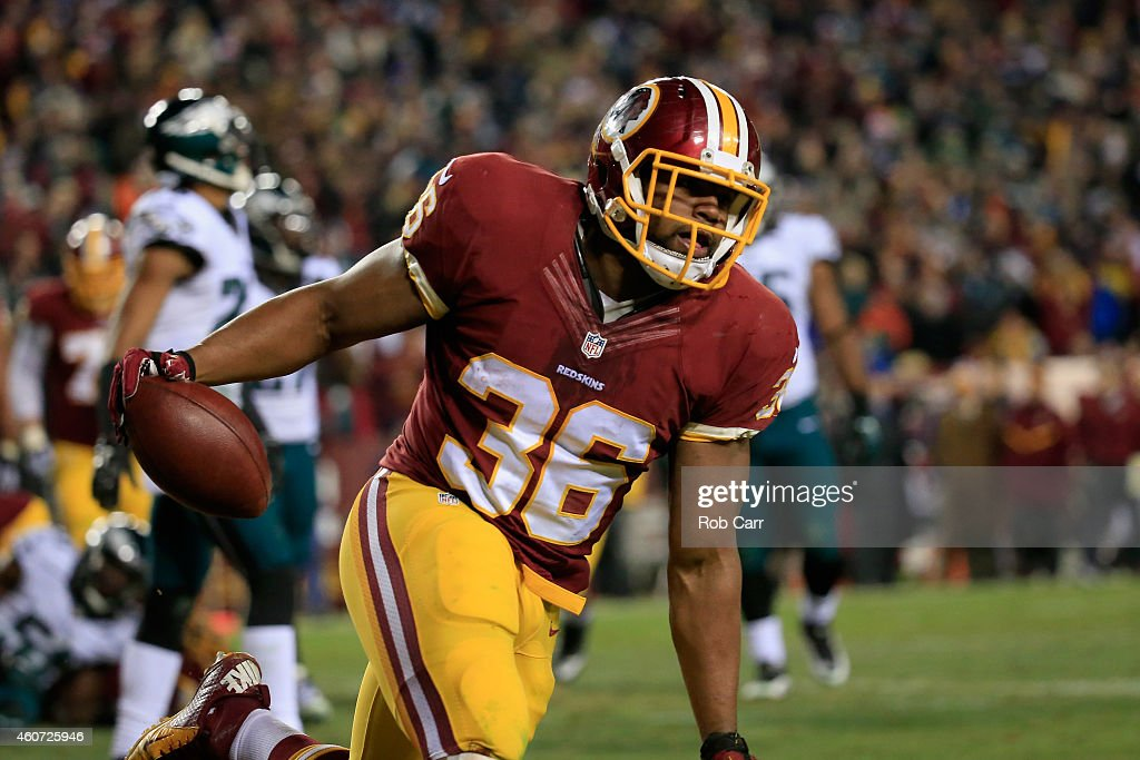 Darrel Young #36 of the Washington Redskins celebrates after scoring a third quarter touchdown against the Philadelphia Eagles at FedExField on December 20, 2014 in Landover, Maryland.
