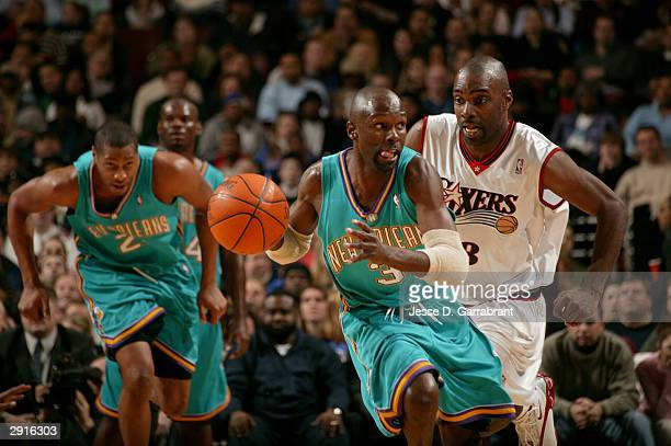 Darrell Armstrong of the New Orleans Hornets drives to the net on a break away past Aaron McKie of the Philadelphia 76ers January 30 2004 at the...