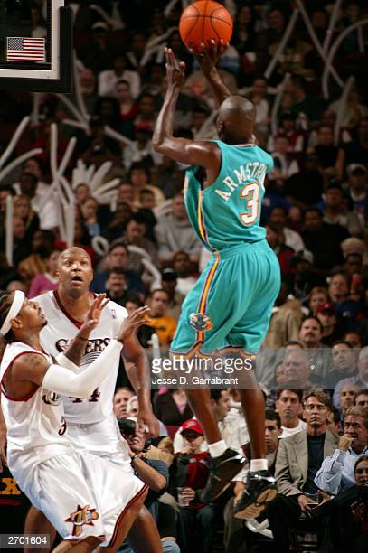 Darrell Armstrong of the New Orleans Hornets takes a shot against Allen Iverson and Derrick Coleman of the Philadelphia 76ers November 5 2003 at the...