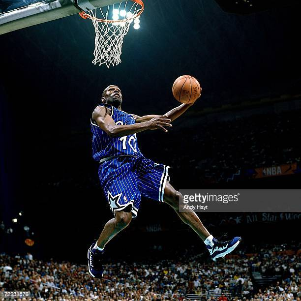 Darrell Armstrong of the Orlando Magic attempts a dunk during the 1996 Slam Dunk Contest on February 10 1996 at the Alamodome in San Antonio Texas...