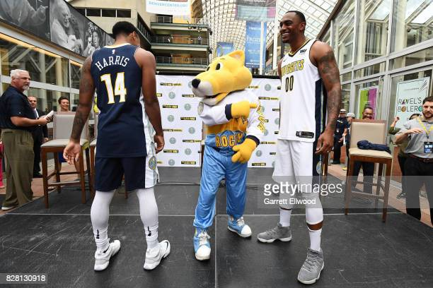 Darrell Arthur and Gary Harris of the Denver Nuggets and Rocky the Mountain Lion mascot of the Denver Nuggets pose for a photo during a jersey launch...