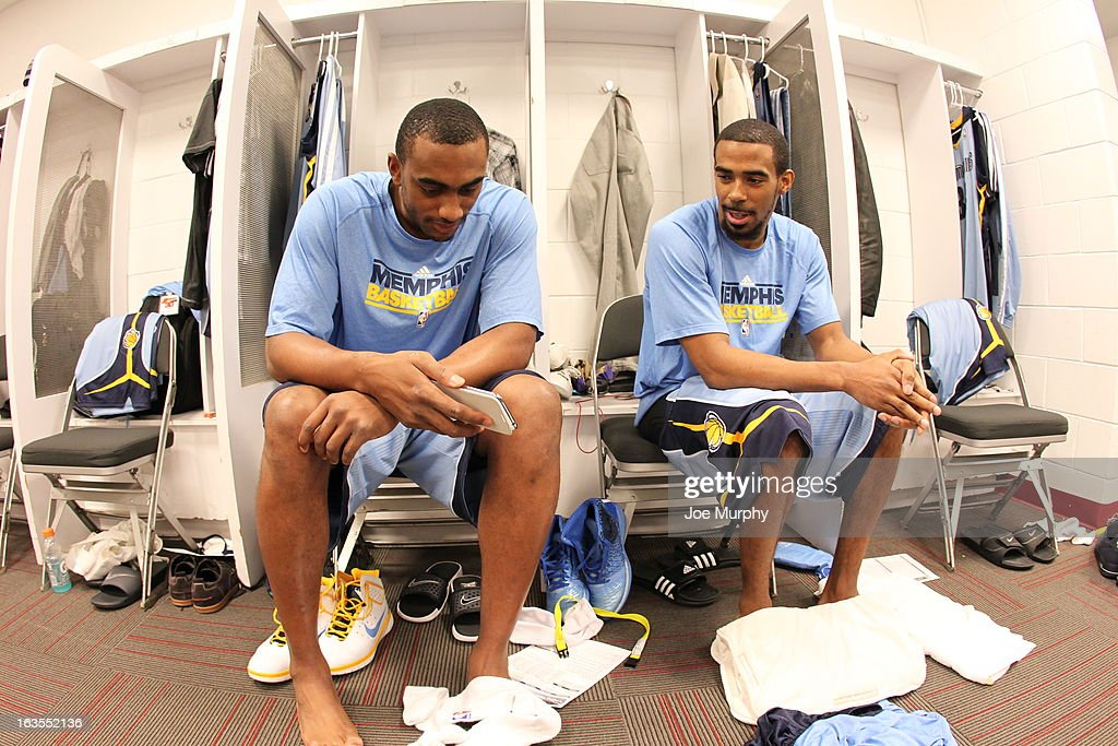 Darrell Arthur #00 and Mike Conley #11 of the Memphis Grizzlies in the locker room before the game against the Miami Heat on March 1, 2013 at American Airlines Arena in Miami, Florida.
