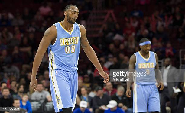 Darrell Arthur and Ty Lawson of the Denver Nuggets walks off the court after a timeout in the game against the Philadelphia 76ers on February 3 2015...