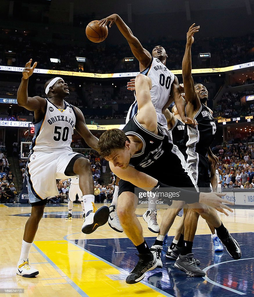 Darrell Arthur #00 and Zach Randolph #50 of the Memphis Grizzlies go for the ball against Tiago Splitter #22 of the San Antonio Spurs in the second half during Game Four of the Western Conference Finals of the 2013 NBA Playoffs at the FedExForum on May 27, 2013 in Memphis, Tennessee.